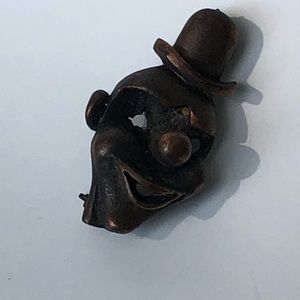 Vintage bronze clown brooch
